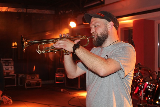 A man is playing the trumpet