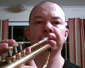 playing trumpet on the side of the mouth